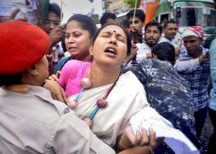 Police personnel detain Youth Congress activists during a protest against price hike of onion and other essential commodities, in Guwahati, Monday, Sept 30, 2019. (PTI Photo)