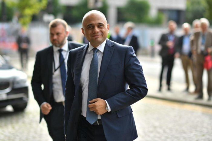 Britain's Chancellor of the Exchequer Sajid Javid arrives at The Midland hotel opposite the Manchester Central convention complex on the second day of the annual Conservative Party conference at the in Manchester, north-west England on September 30, 2019. (AFP)