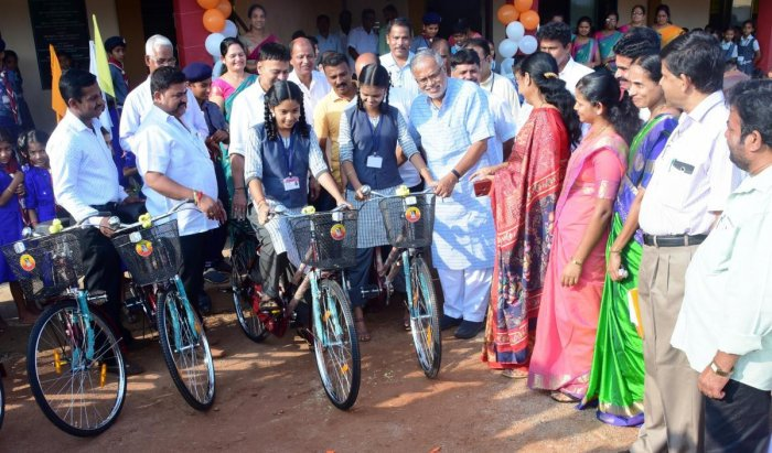 Minister for Primary and Secondary Education S Suresh Kumar distributes bicycles to the students of Government Upgraded Higher Primary School at Daddalakadu in Bantwal taluk.