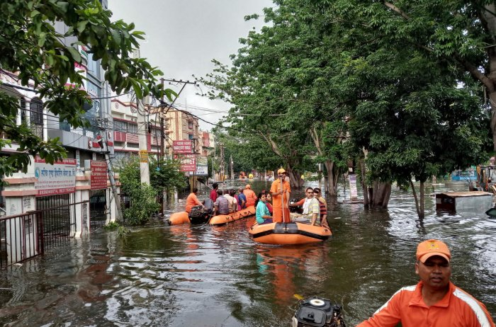 Rescue members evacuate people from a flood-affected neighbourhood in Patna, in the eastern state of Bihar, India, October 1, 2019. REUTERS image