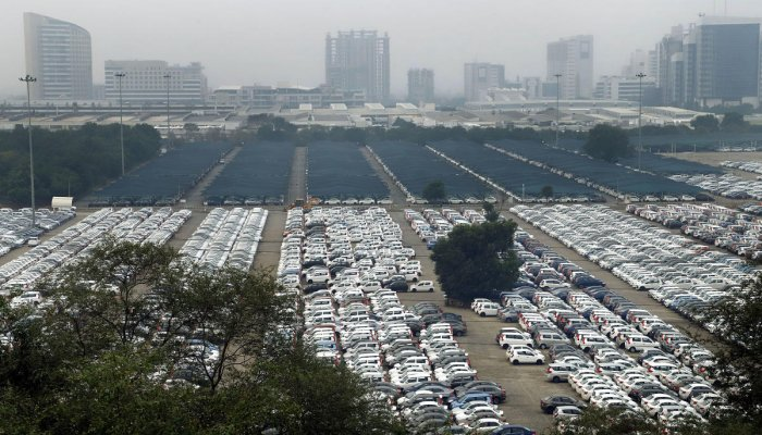 Newly manufactured Maruti Suzuki cars are seen parked inside the company factory in Manesar near Gurugram. (PTI Photo)