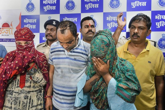Police present four persons arrested in connection with an alleged honey-trapping case in Bhopal, Tuesday, Sept. 24, 2019. Photo/PTI