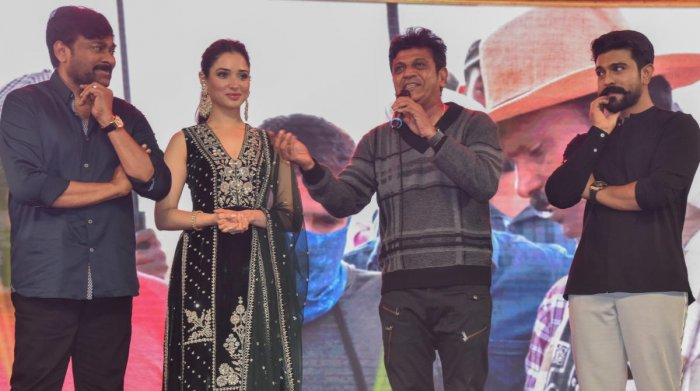 (From left) Chiranjeevi, Tamannaah Bhatia, Shivarajkumar, and Ram Charan at the pre-release event of 'Sye Ra Narasimha Reddy' on Sunday. DH photo by S K Dinesh
