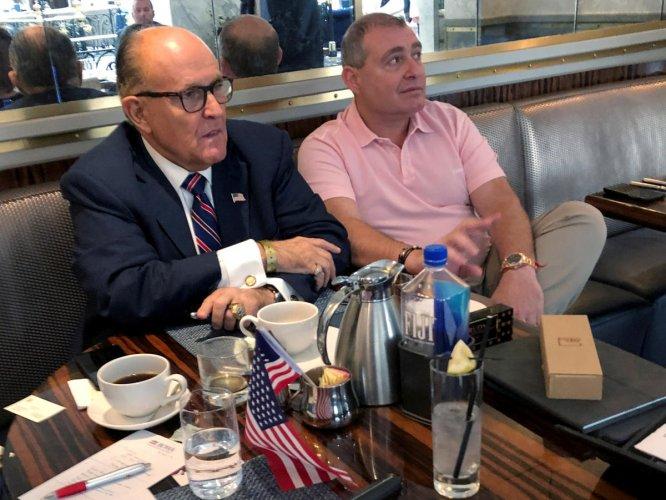 Donald Trump's personal lawyer Rudy Giuliani has coffee with Ukrainian-American businessman Lev Parnas at the Trump International Hotel in Washington, U.S. September 20, 2019. Reuters file photo
