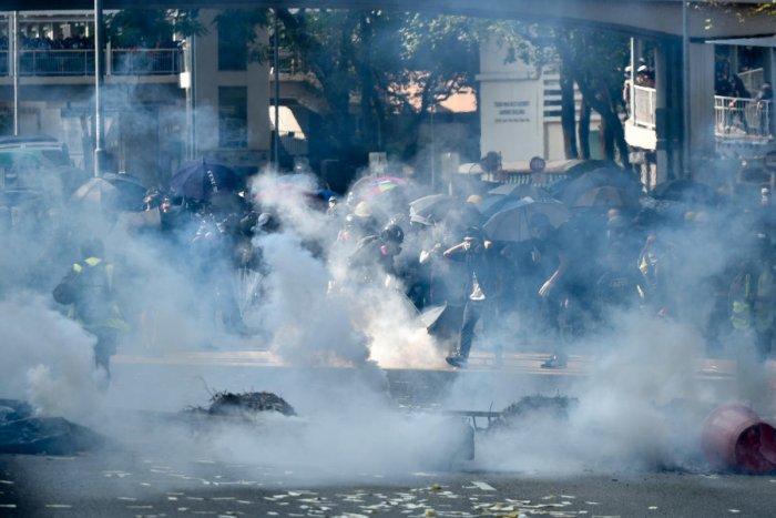Police fire tear gear to disperse protesters in Tsuen Wan district in Hong Kong on October 1, 2019, as the city observes the National Day holiday to mark the 70th anniversary of communist China's founding. (Photo AFP)