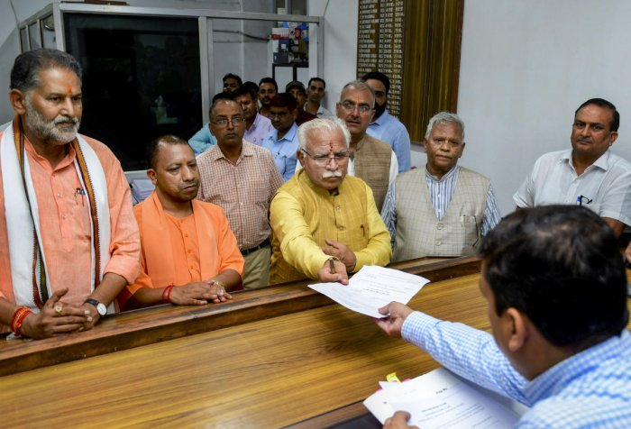 Haryana Chief Minister Manohar Lal Khattar files nominations from Karnal assembly seat at SDM Office, in Karnal, Tuesday, Oct. 1, 2019. Uttar Pradesh Chief Minister Yogi Adityanath and Union Minister Rattan Lal Kataria are also seen. (PTI Photo)