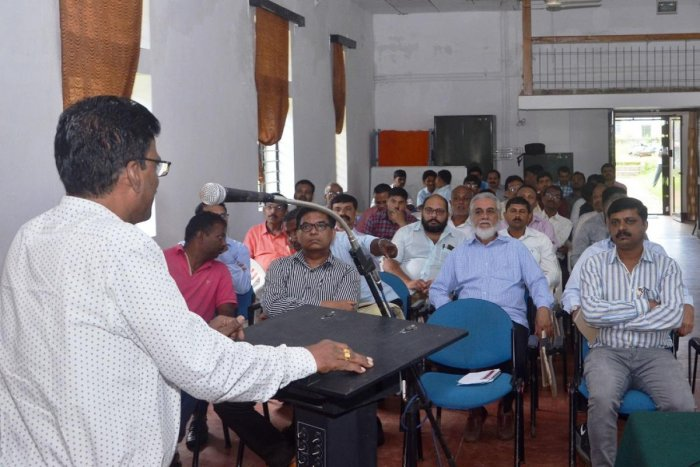 Central Coffee Research Institute (CCRI) in-charge director Dr Sooryaprakash Rao speaks at an International Coffee Day programme at Balehonnur.