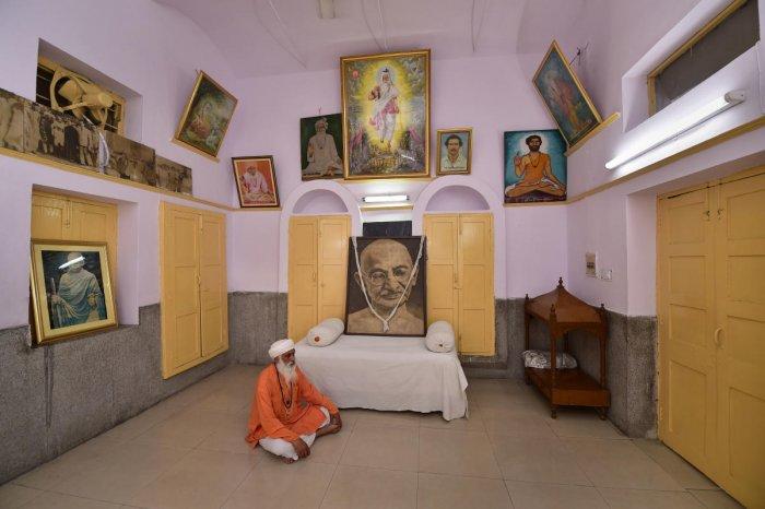 Portraits of Mahatma Gandhi seen inside a Valmiki Temple, on Mandir Marg, in New Delhi, Thursday, Sept 26, 2019. (PTI Photo)