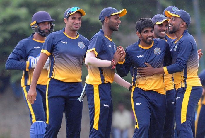 B Sandeep (third from right) celebrates with teammates after picking up a wicket in Hyderabad's 21-run win over Karnataka in Alur on Tuesday. PUSHKAR V/ DH PHOTO
