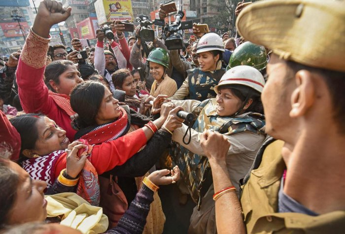 "Police personnel clash with protesting Anganwadi volunteers during the 48-hour-long nationwide general strike called by central trade unions protesting against the ""anti-people"" policies of the Centre, in Patna on Jan 8, 2019. Photp/PTI"
