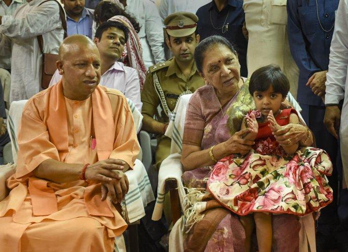 Uttar Pradesh Governor Anandiben Patel and Chief Minister Yogi Adityanath during the 150th birth anniversary celebrations of Mahatma Gandhi, in Lucknow. (PTI Photo)