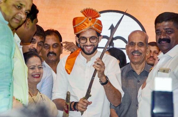 Yuva Sena chief Aaditya Thackeray, the elder son of party chief Uddhav Thackeray, presented with a sword as he announces his candidature from Worli seat for upcoming Maharashtra Assembly elections during a rally, in Mumbai. (PTI Photo)