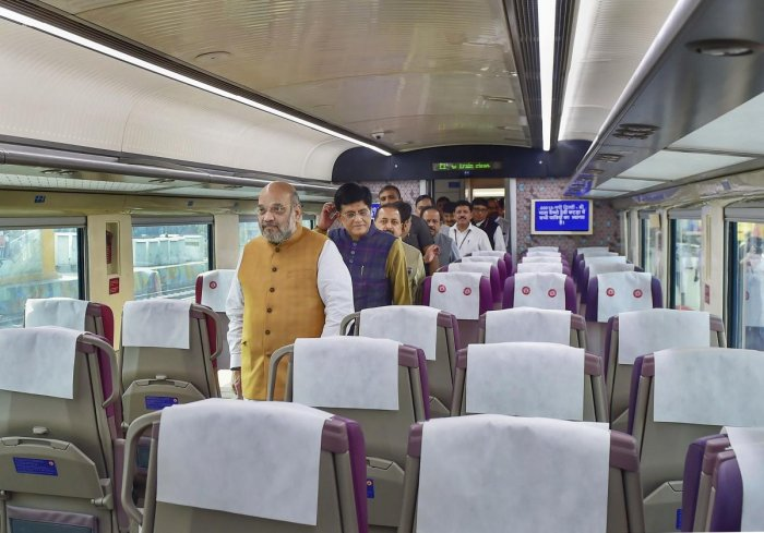Union Home Minister Amit Shah inside a coach of the semi -high-speed train Vande Bharat Express before its flags off ceremony at New Delhi Railway Station, in New Delhi on Thursday. (PTI Photo)
