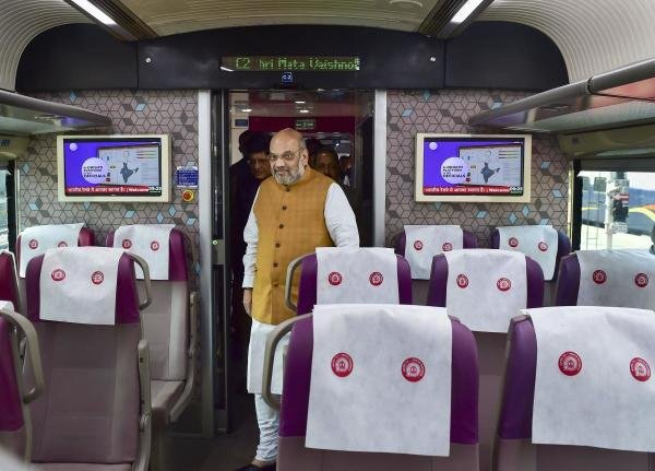 Union Home Minister Amit Shah inside a coach of the semi -high-speed train Vande Bharat Express before its flags off ceremony at New Delhi Railway Station, in New Delhi. (Photo/PTI)
