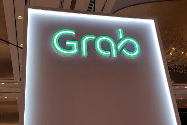 A Grab logo is pictured at the Money 20/20 Asia Fintech Trade Show in Singapore. (Reuters photo)