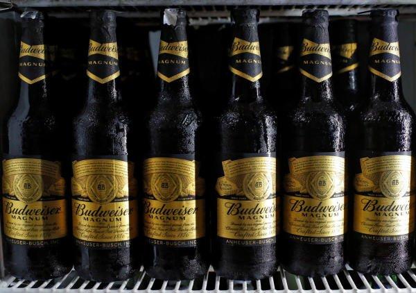 Budweiser beer bottles are seen in a cooler at a liquor shop. (Photo/Reuters)