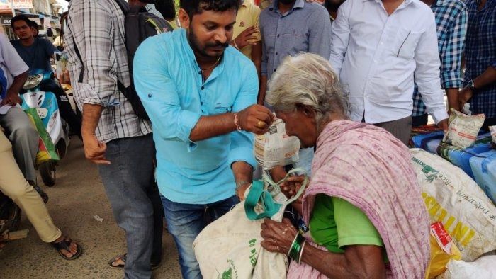 Members of the Facebook group exchanging plastic with rice in Peddapuram
