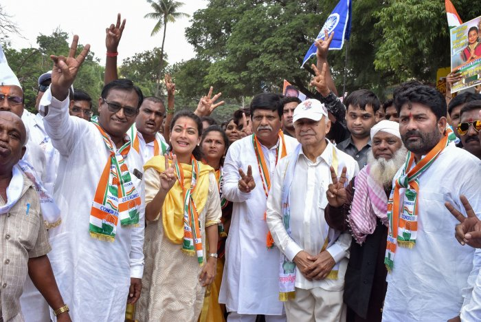 Congress candidate for Solapur seat Praniti Shinde with her father and former Union minister Sushilkumar Shinde and other leaders during her nomination filing procession, in Solapur, Maharashtra. (PTI Photo)
