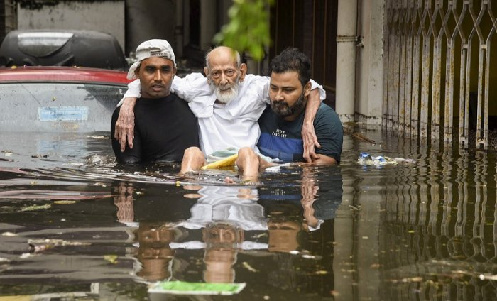 An elderly person being rescued from a flood-affected colony at Rajendra Nagar in Patna. (PTI Photo)