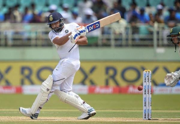 India's Rohit Sharma plays a shot on the 2nd day of the 1st test cricket match played against South Africa at Dr YS Rajasekhara Reddy ACA-VDCA Cricket Stadium, in Visakhapatnam. (PTI photo)