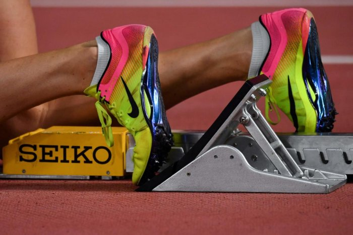 An athlete wears a pair of Nike shoes with running spikes on the track at the 2019 IAAF Athletics World Championships at the Khalifa International stadium in Doha on October 2, 2019. (Photo by AFP)