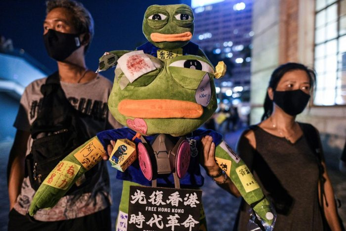 He may have become a far-right internet meme in the West, but Pepe the Frog's image is being rehabilitated in Hong Kong where democracy protesters have embraced him as an irreverent symbol of their resistance. (Photo by AFP)