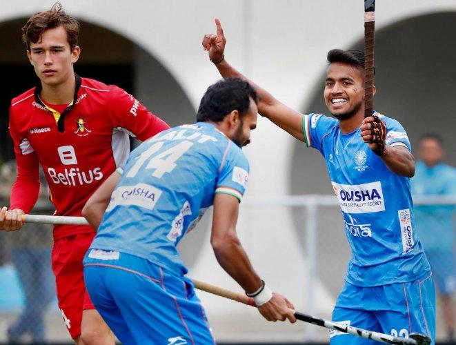 Indian Men's hockey team player Vivek Sagar Prasad celebrates with teammate after scoring a goal against World Champions Belgium during their Tour of Belgium, in Antwerp, Belgium on Thursday. (PTI Photo)