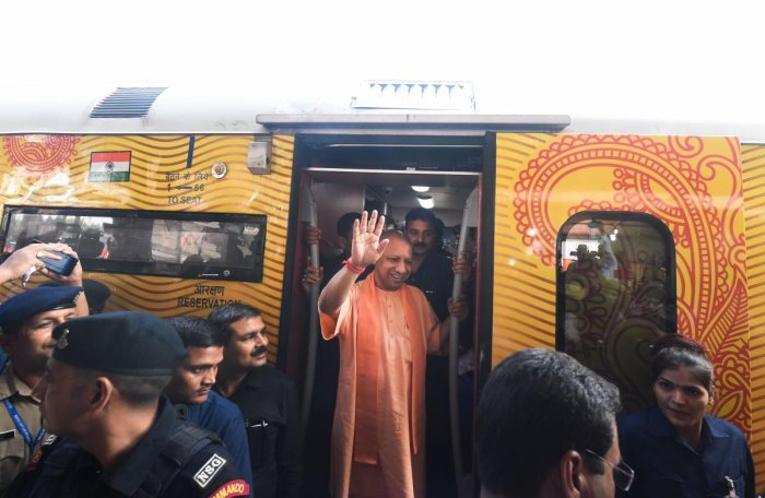 Uttar Pradesh Chief Minister Yogi Adityanath waves after visiting the Lucknow-Delhi Tejas Express, India's first 'private' train by IRCTC, during its flag-off ceremony at the Charbagh Railway station. PTI