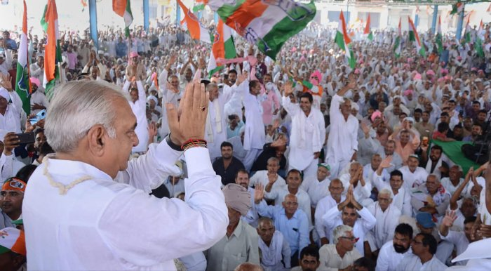 Former Haryana Chief Minister and senior Congress leader Bhupinder Singh Hooda greets his supporters during a rally before filing his nomination papers for the forthcoming Assembly polls, in Rohtak, Friday, Oct. 4, 2019. (PTI Photo)