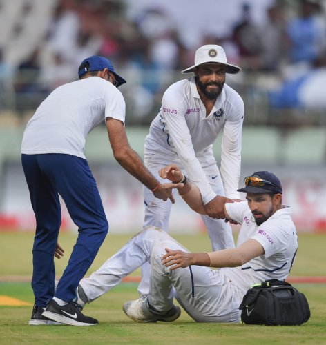 India's Ishant Sharma being helped after he suffered from an injury on third day of the 1st cricket test match between India and South Africa at Dr YS Rajasekhara Reddy ACA-VDCA Cricket Stadium, in Visakhapatnam. (PTI photo)