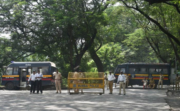 Police cordon off the area following a protest against the tree-cutting, being carried out for the Metro car shed project, at Aarey colony in Mumbai on Saturday. (PTI Photo)