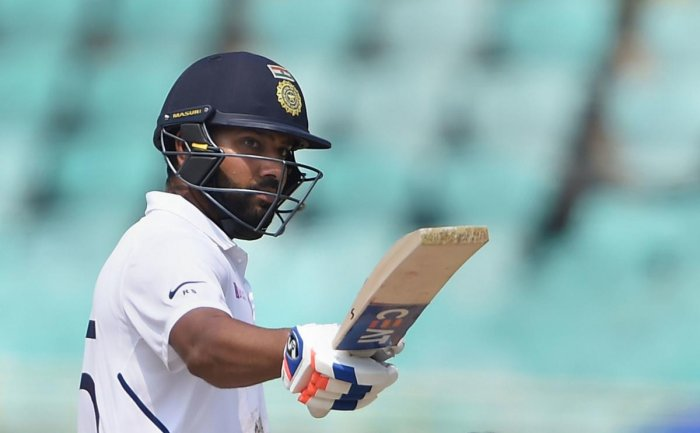 India's Rohit Sharma celebrates after scoring half-century on the fourth day of the first cricket test match against South Africa. (PTI Photo)