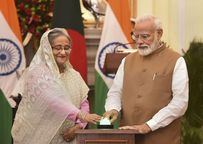 Prime Minister Narendra Modi with his Bangladeshi counterpart Sheikh Hasina launches a bilateral project after a meeting at Hyderabad House in New Delhi, Saturday, Oct. 5, 2019. (PTI Photo)