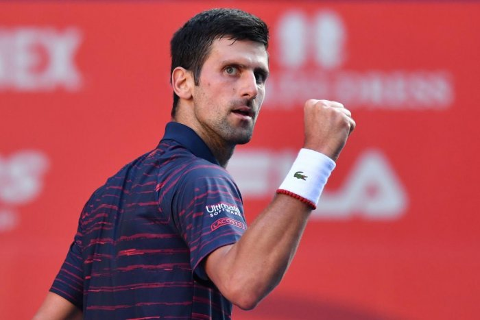 Serbia's Novak Djokovic reacts following a point against Belgium's David Goffin in their men's singles semi-final match at the Japan Open tennis tournament in Tokyo on October 5, 2019. (AFP)