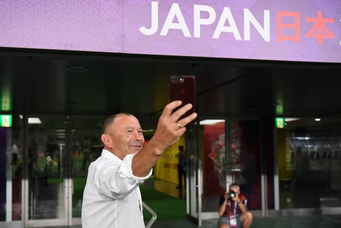 England's head coach Eddie Jones takes a selfie after victory during the Japan 2019 Rugby World Cup Pool C match between England and Argentina at the Tokyo Stadium in Tokyo on October 5, 2019. (AFP)