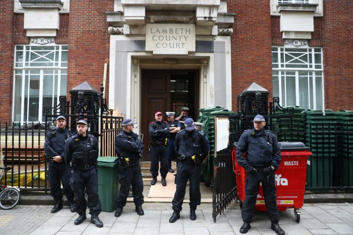 Police officers stand guard outside Lambeth County Court, during a raid on an Extinction Rebellion storage facility, in London, Britain October 5, 2019. Reuters