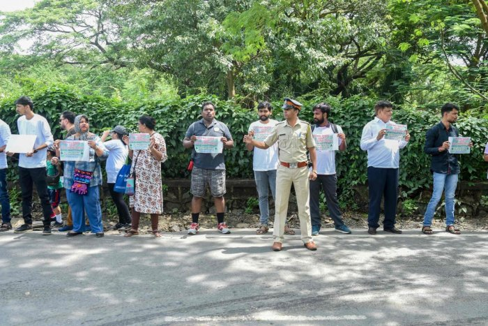 """residents protesting against the destruction of Aarey forest which they call """"Mumbai's Amazon"""", after the government approved cutting down 2,700 trees for constructing a metro train car shed, in Mumbai. (Photo by AFP)"""