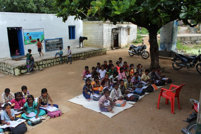 (Left) Government primary school students of Horatur village in Wadagera taluk in Yadgir district attend classes under the shade of trees as the schoolbuilding is unsafe for use; patients in a public health centre, which does not have a doctor, in Yadgir