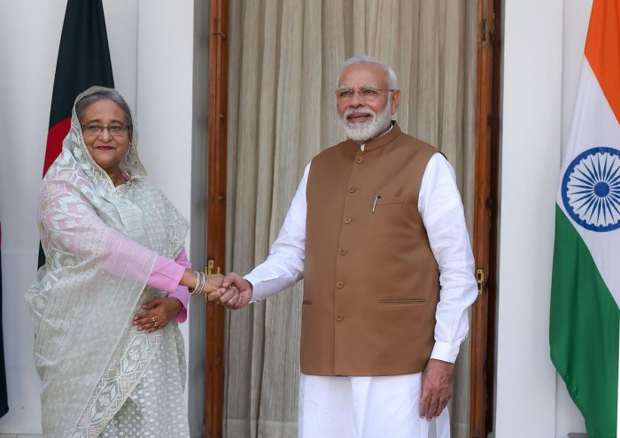 Prime Minister Narendra Modi shakes hands with his Bangladeshi counterpart Sheikh Hasina at Hyderabad House in New Delhi on Saturday. PTI