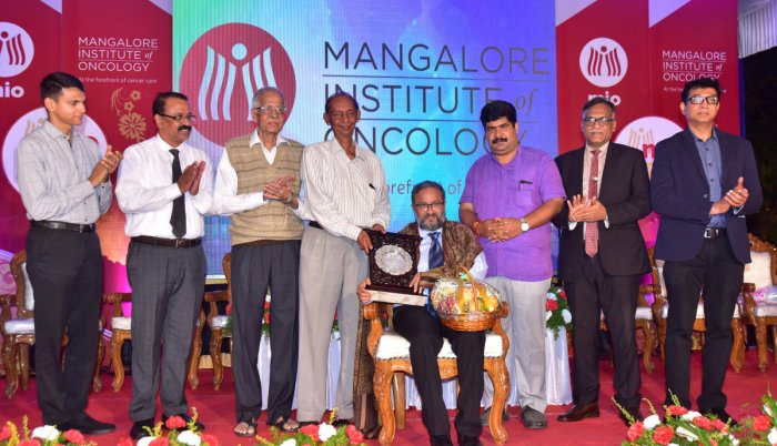 Mangaluru South MLA D Vedavyas Kamath felicitates Dr Suresh Rao, Mangalore Institute of Oncology (MIO) Director and Radiation Oncology head, at the MIO Day programme held on the hospital premises on Saturday.
