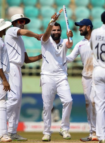 Mohammed Shami holds up a broken stump after dismissing South Africa's Dane Piedt in India's resounding win in Visakhapatnam. PTI