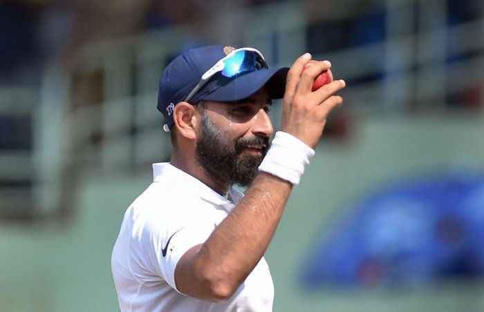 Indian Mohammed Shami leaves the ground in happiness after bagging a match-winning five-wicket haul against South Africa in the first Test in Visakhapatnam. PTI