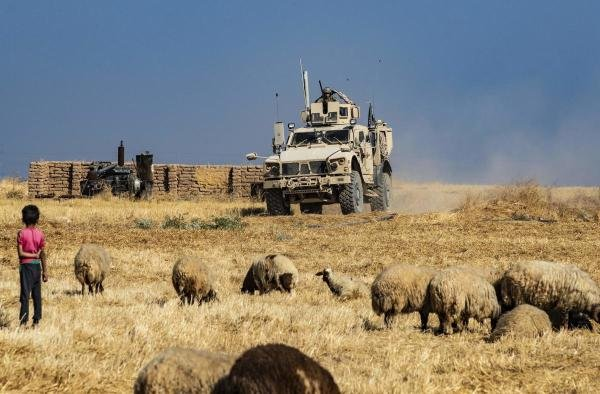 A US military vehicle takes part in joint patrol with Turkish forces in the Syrian village of al-Hashisha on the outskirts of Tal Abyad town along the border with Turkey, on October 4, 2019. (AFP photo)