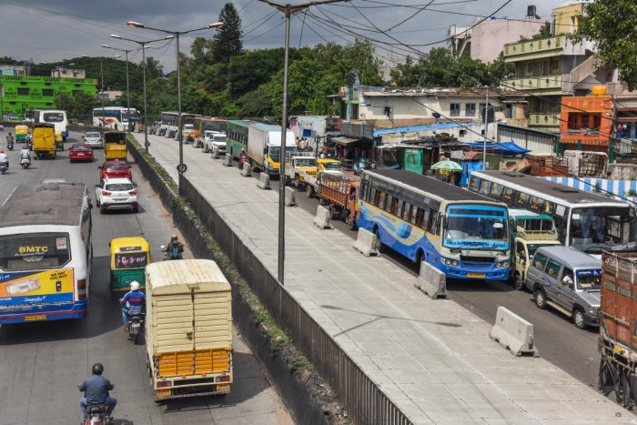 Due to white topping work, traffic is affected near tool gate, Mysuru road in Bengaluru on Monday. Photo by S K Dinesh