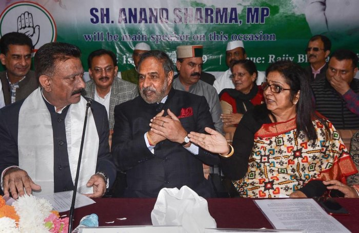 Rajya Sabha member Anand Sharma flanked by Congress state President Kuldeep Singh Rathore and state party in-charge Rajni Patil during a meeting, in Shimla, Tuesday, Oct. 1, 2019. (PTI Photo)