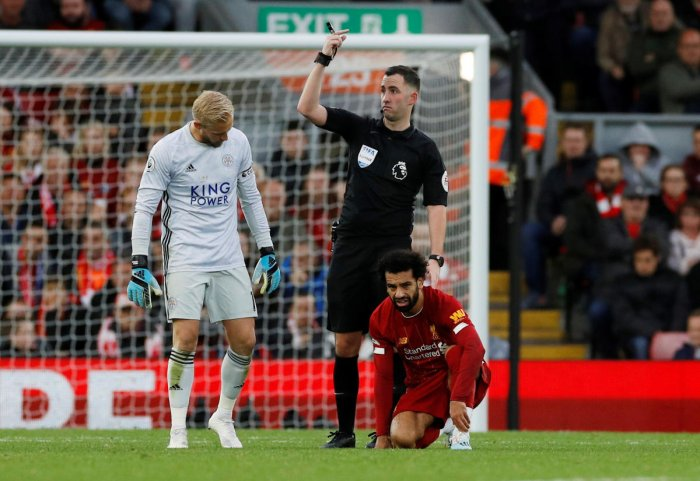 Referee Chris Kavanagh gestures after Liverpool's Mohamed Salah goes down due to an injury. REUTERS