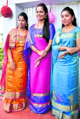Top women officials of the district, Superintendent of Police Dr Suman D Penneker, Deputy Commissioner Annies Kanmani Joy and Zilla Panchayat CEO K Lakshmi Priya wearing sarees in traditional Kodava style.