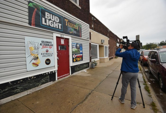KANSAS CITY, KANSAS - OCTOBER 06: A local news videographer records footage of the entrance to Tequila KC bar were 9 people were shot and four killed on October 06, 2019 in Kansas City, Kansas. ( Ed Zurga/Getty Images/AFP)