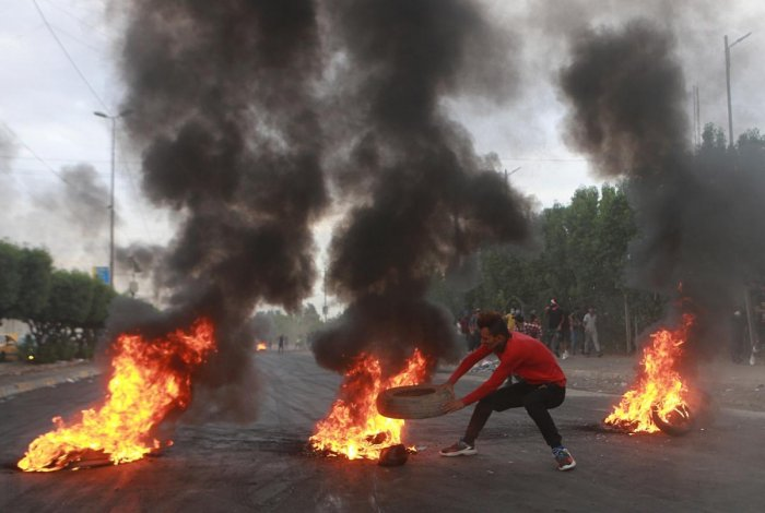 Baghdad: Anti-government protesters set fires and close a street during a demonstration in Baghdad, Iraq, Sunday, Oct. 6, 2019. The protests began with demands for jobs and an end to corruption, and now include calls for justice for those killed in the pr