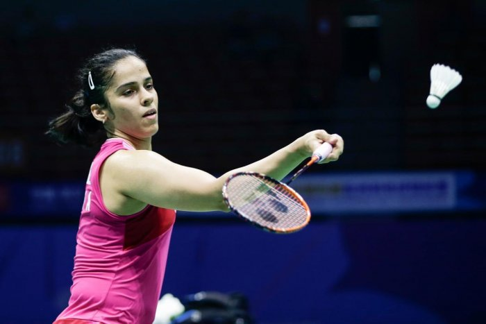 Saina Nehwal of India hits a return against Kim Ga-eun of South Korea during their women's singles second round match at the 2019 Badminton Asia Championships in Wuhan in central China's Hubei province on April 25, 2019. AFP file photo